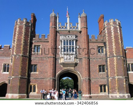 LONDON, UNITED KINGDOM - SEPT 5, 2004:  People look at Entrance to Hampton Court Palace Home of Henry VIII on Sept 5, 2004 in borough Richmond upon Thames, London, United Kingdom 