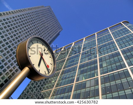 London, United Kingdom â?? September 26, 2009: Skyscrapers in Canada Square Canary Wharf Docklands. The clock is one of six and a public art sculpture