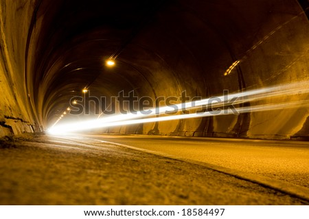 lone car moving fast in tunnel. low angle view