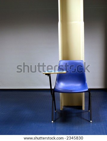 lone desk against a metal beam - stock photo