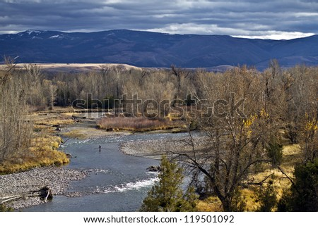 Lone Fisherman on the Gallatin River - stock photo