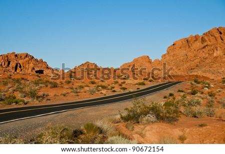 lone highway through the valley of fire - stock photo