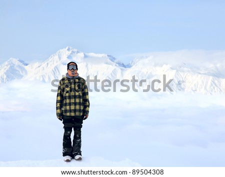 Lone man in a beautiful mountain landscape of the Caucasus Mountains on Krasnaya Polyana - stock photo