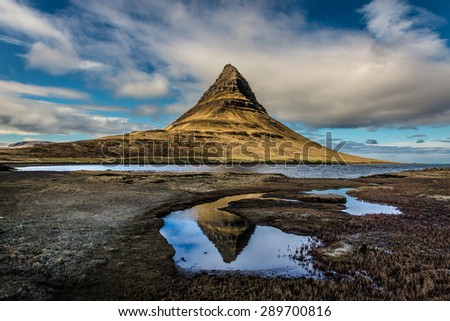 Lone mountain in a barren Iceland landscape.