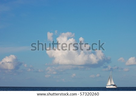 lone Sailing boat among clouds - stock photo