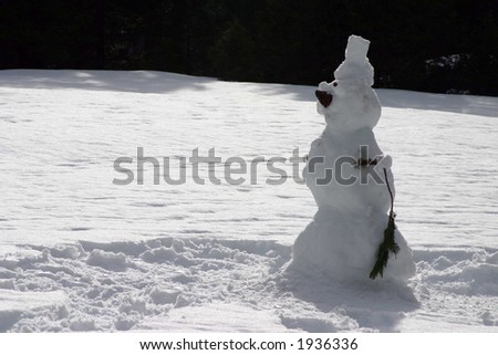 Lone snowman in the field - stock photo