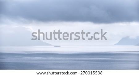 Loneliness. Norwegian fjord - stock photo