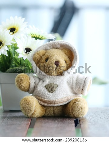 Loneliness teddy bear in Sweater - stock photo