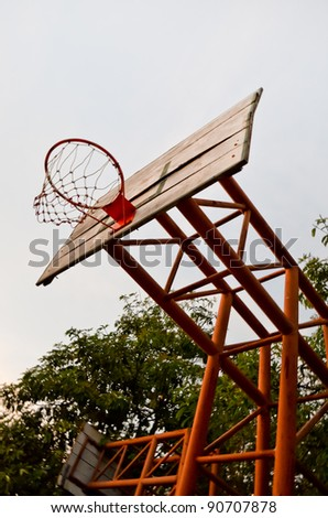 lonely basketball hoop in last sunlight - stock photo