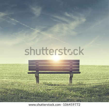 Lonely Bench in a Park During Sunset - stock photo