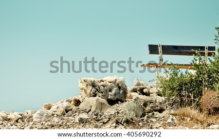 Lonely bench on the white rocks - stock photo