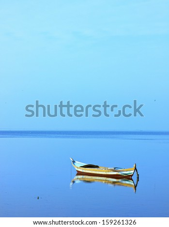 Lonely boat - stock photo