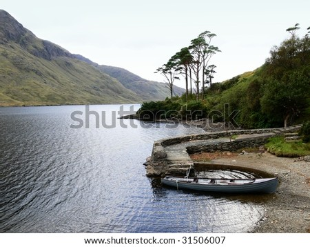 Lonely boat in a rugged Irish landscape - stock photo