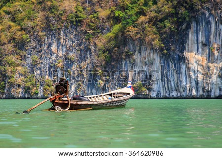 Lonely boat Longtail near islands in the Andaman Sea