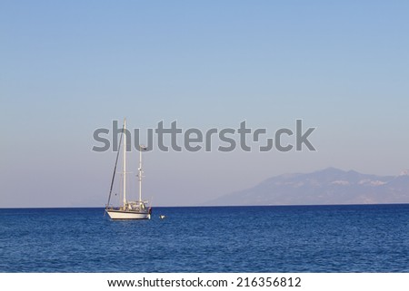 Lonely boat on a sea - stock photo