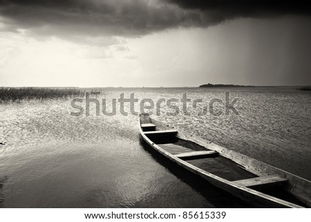 Lonely boat on lake. Composition of nature. - stock photo