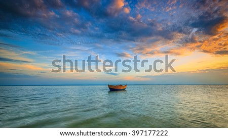 Lonely boat on the Baltic Sea at sunset. HDR - high dynamic range - stock photo