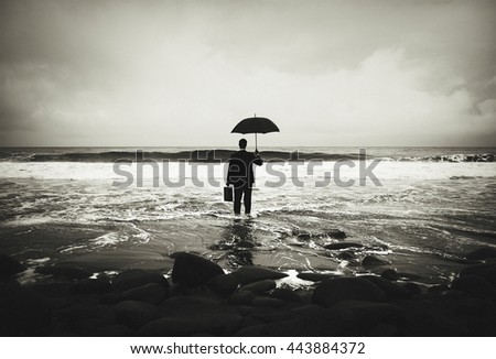 Lonely Businessman Alone in the Beach - stock photo