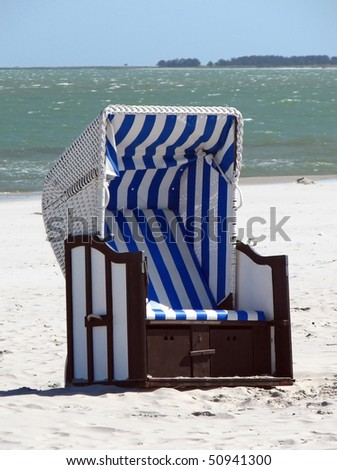 Lonely canopied beach chair