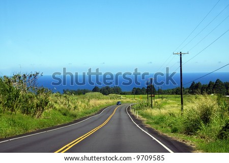 Lonely car on the road on Big Island, Hawaii - stock photo