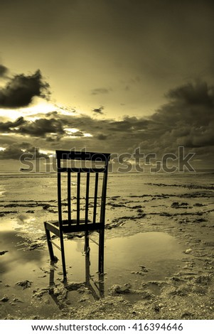 Lonely chair at stunning sunset. Nature composition.
