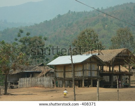 Lonely child in hilltribe village, Shan State, Myanmar (Burma) - stock photo