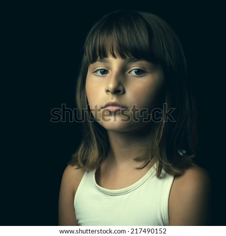 Lonely child portrait with Color fading instagram effect  - stock photo
