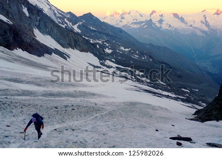 Lonely climber on its way to Lagginhorn's summit in the Alps, Switzerland - stock photo