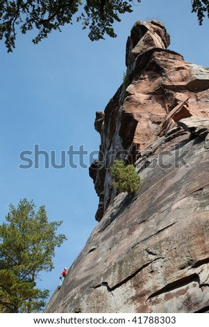 lonely climber, up the hill - stock photo