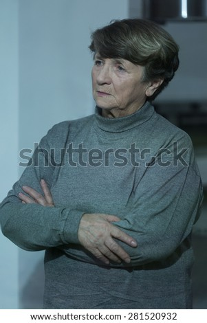 Lonely depressed retired women waiting for family - stock photo