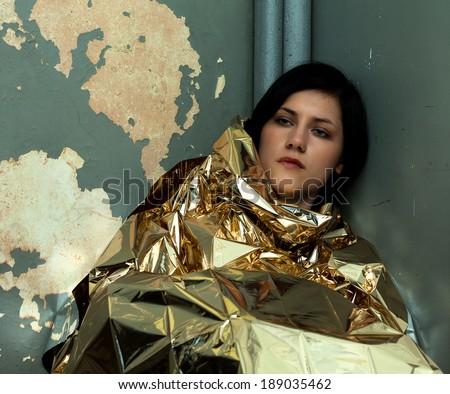 Lonely drug addict woman in the slum - stock photo