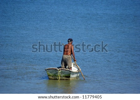 Lonely fisherman going for a boat trip - stock photo