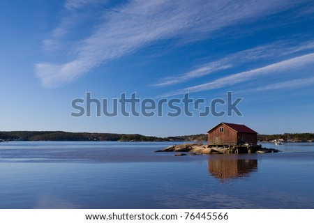 Lonely fishermans shed - stock photo