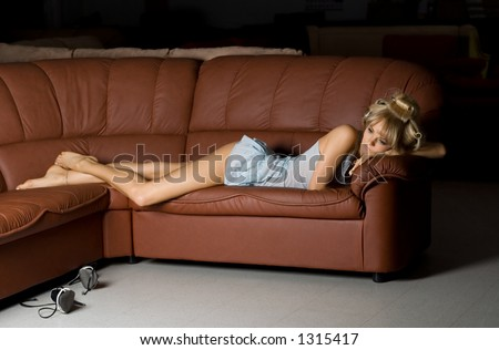 lonely girl in blue lingerie on the sofa