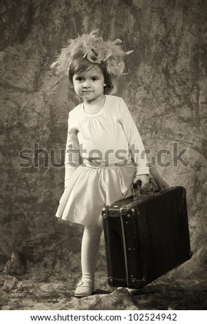 Lonely girl with suitcase - stock photo