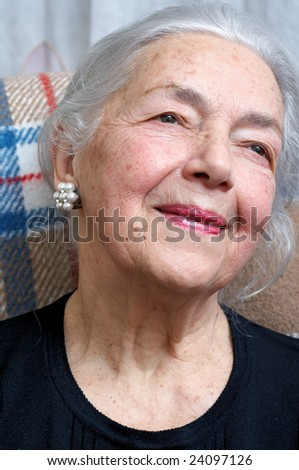 Lonely grandmother portrait - stock photo