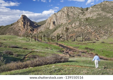 lonely hiker contemplating mountain vista  in springtime- Eagle Nest Open Space near Fort Collins, Colorado - stock photo