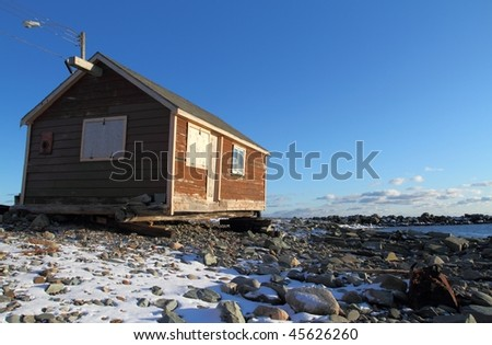 Lonely house in winter - stock photo