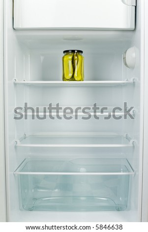 Lonely jar of gherkins in fridge. Front view - stock photo