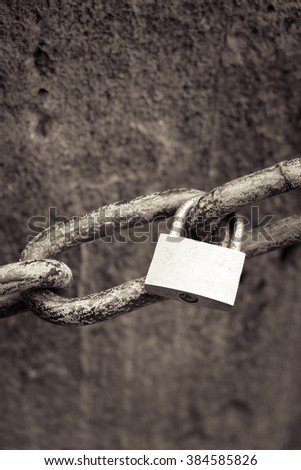 lonely love lock s hanging on a chain - stock photo