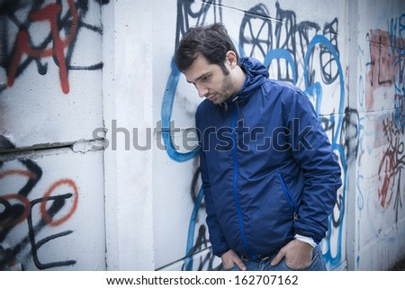 lonely man in city street - stock photo