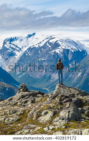 Lonely man on top of mountain in Norway - stock photo