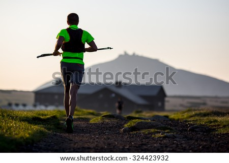 Lonely man running in on a mountain run