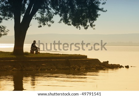 Lonely old angler - stock photo