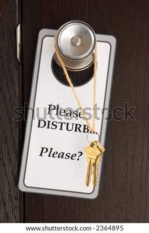 lonely plea for attention - a sign and keys hanging on a doorknob - stock photo
