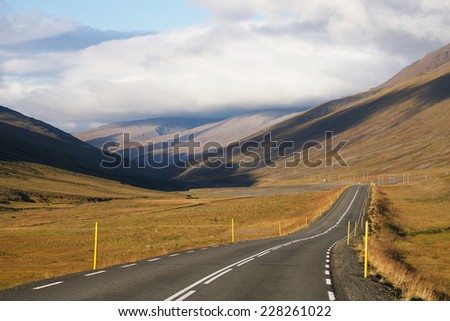 Lonely road between mountains, Iceland - stock photo