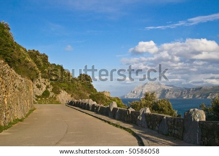 lonely road near the sea - stock photo