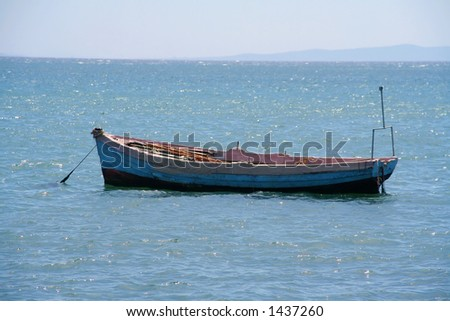 lonely rowing boat / fisherboat