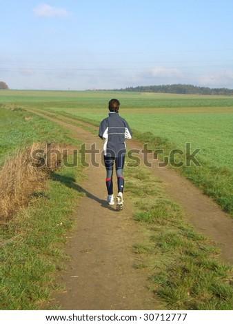 Lonely running women - stock photo