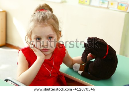 lonely sad little blond girl think close up portrait with stuffed bear toy - stock photo
